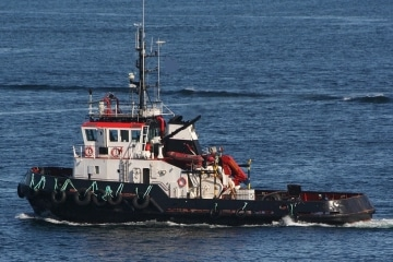 Conventional Twinscrew tug with Bowthruster